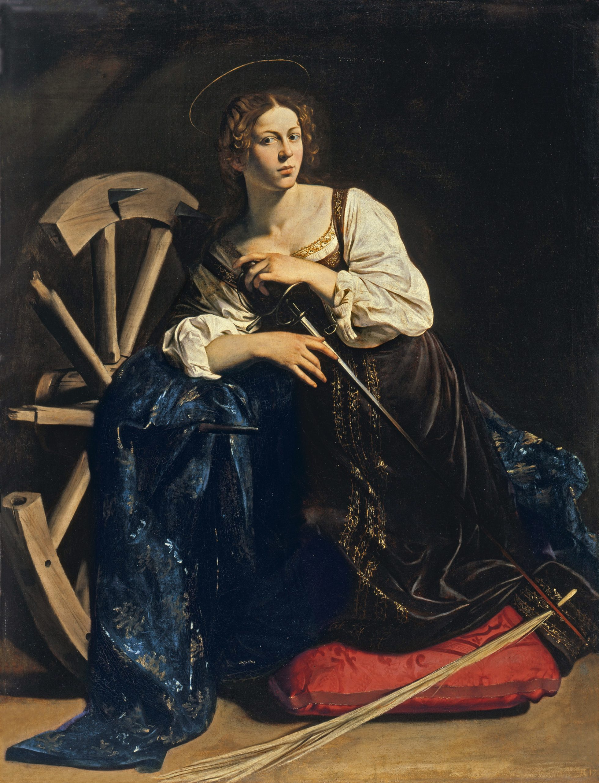 """Święta Katarzyna Aleksandryjska """"urodziła się ok. 290 roku wAleksandrii. Pochodziła zkrólewskiego rodu. Jej nauczycielami byli najsławniejsi mędrcy, dzięki czemu uzyskała solidne wykształcenie iprzyjęła wiarę chrześcijańską. Kiedy zapanowania cesarza Maksencjusza nakazano wszystkim wCesarstwie Rzymskim składać ofiary bogom, młoda Katarzyna wystąpiła przedcesarzem, mówiąc mu ookrucieństwie tego nakazu. Zarzuciła mu niesprawiedliwość iprześladowanie chrześcijan. Cesarz, niepotrafiąc oprzeć się argumentacji Katarzyny, wyznaczył 50 filozofów, aby ją przekonali oniedorzeczności wiary wChrystusa. Dziewczyna była jednak nieugięta, co więcej, przekonała mędrców, byprzyjęli jej wiarę, zaco ponieśli męczeńską śmierć. Orękę Katarzyny starał się władca wschodniej części imperium rzymskiego – Maksymian, leczKatarzyna odrzuciła jego starania. Została więcuwięziona. Odwiedzała ją m.in.cesarzowa Augusta, którą Katarzyna zdołała nawrócić. Rozzłoszczony cesarz nakazał Katarzynie wyrzec się swej wiary, leczta niezrobiła tego. Została skazana naśmierć przezłamanie kołem. Gdyuruchamiano machinę, nagle pękły sznury, którymi była związana, amachina się rozpadła. Ostatecznie Katarzynę ścięto mieczem ok. 307 roku. Tradycja podaje, żejej ciało nagórę Synaj przeniosły anioły. (...) Świętą Katarzynę zapatronkę wzięli kolejarze zMysłowic, zakładając w1851 r. swój pierwszy związek zawodowy. Kult świętej przetrwał wśród kolejarzy dodziś: świadczą onim liczne wizerunki św.Katarzyny wpolskich lokomotywowniach oraznasztandarach."""" (...) Wikonografii przedstawiana jest jako dziewczyna zkoroną nagłowie, mieczem, książką, palmą albopodtrzymująca koło zostrymi hakami, służące dotorturowania. Jej święto patronalne przypada 25 listopada, wtedy też – od1991 r. – kolejarze mają swój dzień. Wtym roku [2007] przypada 1700-lecie śmierci patronki kolejarzy. Wzwiązku ztym jej relikwie są obwożone pomiejscach kultu św.Katarzyny, m.in.wPolsce."""""""